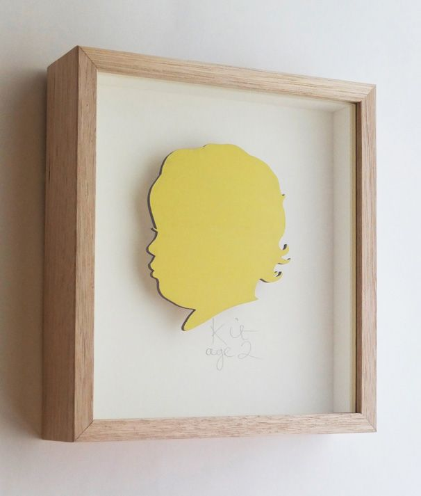 Kit. 3mm plywood silhouette painted in Bittersweet, cream mount. Name/age hand written in pencil. Oak frame. 250mm high x 230mm wide x 50mm deep.