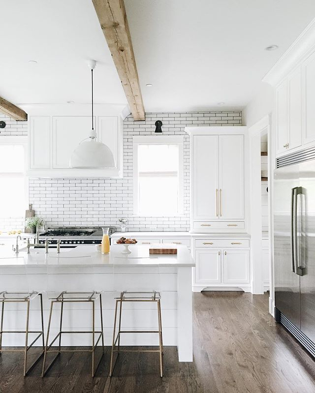 white + subway tile + wood beams