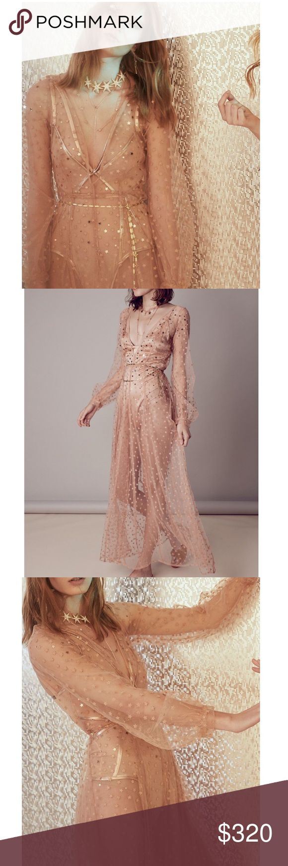 New For Love & Lemons All that Glitters Dress NWT Brand new with tags, this gorgeous For Love & Lemons All That Glitters Maxi Dress in almond is the perfect dress for the summer season. Featuring dainty embroidered stars and an allusive v-neck line. With sheer long sleeves and a maxi skirt silhouette and back cut-out.  This dress comes with matching slip show in last picture. $334 on FLL website.  Back Cut-out With Button Closure Mesh Fabric With Embroidered Stars  Hidden Back Zipper Closure…
