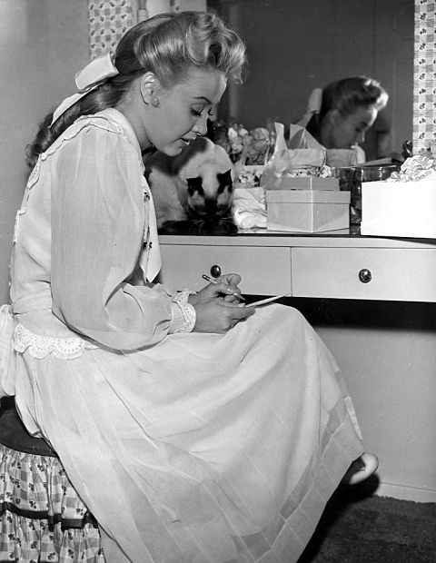 Jane Powell and her cat Demi  Publicity photo during the filming of Two Weeks With Love - 1950