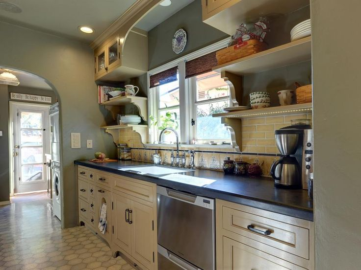 This Mediterranean Style Kitchen Had Beautiful Cabinetry And Hex Tile Floor,  With Open Shelving Providing