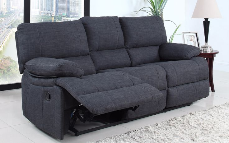 Classic style oversize and overstuffed reclining sofa featuring soft linen fabric upholstery with overstuffed back rest and arm rests for extra comfort. Extra wide to add comfortability with full recl