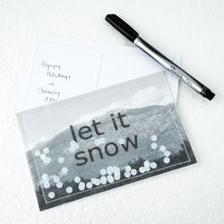 Send wintery holiday wishes with this easy Snow globe postcard.