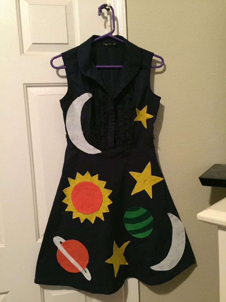 Ms. Frizzle' Costume - found a dark blue dress at Salvation Army - used felt material (you can get 3 sheets for $1) to create outer space shapes - used a hot glue gun to put the shapes onto the dress NOTE: make sure to put cardboard inside the dress underneath where you are glueing!!! Otherwise, the glue will penetrate through to the backside of the dress
