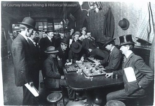 Wyatt Earp dealing at one of the Oriental Saloon's faro tables. To his right, Doc Holliday. Wyatt Earp became manager of the Oriental Saloon, entitling him to receive one-quarter interest in its faro concession. Tombstone, Arizona  January 1881 © Bisbee Mining and Historical Museum