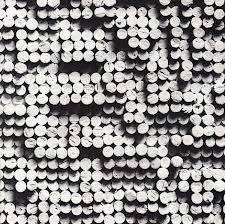 Work of Radek Kratina, Czech designer (1928-1999). These are corks painted white, and arranged at different heights.  Google Image Result for http://www.antikvariat-vltavin.cz/uploads/600x600/books/94f470984fb5a88c96bd52ab146984276913a9cf.jpg