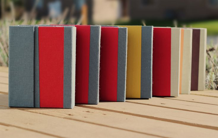 Sample prototypes for the TRIO Notebook System. We've finally narrowed down the notebook paper that we think is just amazing and we've also got the main color choices narrowed down to three or four schemes (none of these colors are in the photo).