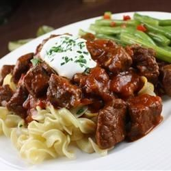 Hungarian Goulash- I toss the cubed meat in some flour before sauteeing it to help thicken it a little bit. Use 1 tsp. of salt, add more later if needed. This would work as a great crock pot meal too, save the time of satueeing everything and just dump and go.