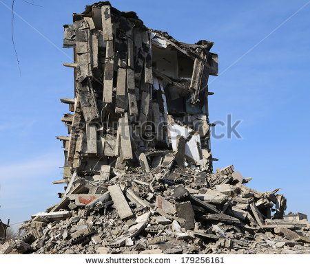 tearing down concrete buildings