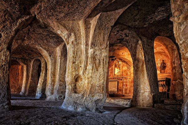 """""""Le grotte di S. Michele"""" It is a rock church in the district of Fondovico on the left ridge of the ravine. It is known as the first cathedral of the city. Located in a caves complex and sorrounded by a picturesque landscape, the interior has five naves. It was dug probably between the 8th and 9th centuries, it was later pointed according to the oriental technique....."""