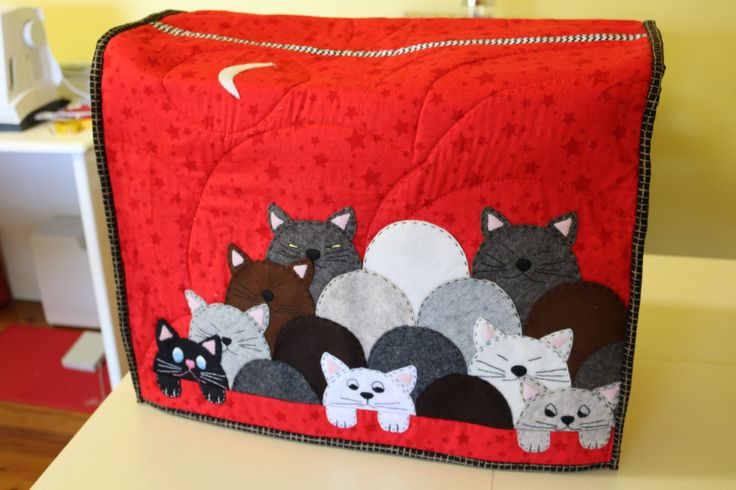 Kitty Kat sewing machine cover. The cats are wool felt with embroidered faces.