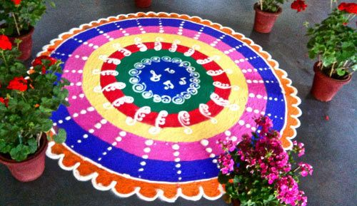Wondering how the North Indian style differs when it comes to rangoli? Here is a list of the top 10 North Indian rangoli designs. See for yourself!