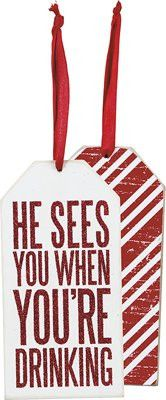 """- One (1) wine bottle tag (image shows both sides) - Measures approximately 6"""" x 3"""" x 0.125"""" - Made of wood with red glitter text - Comes with red ribbon - Makes a great Christmas ornament too!"""