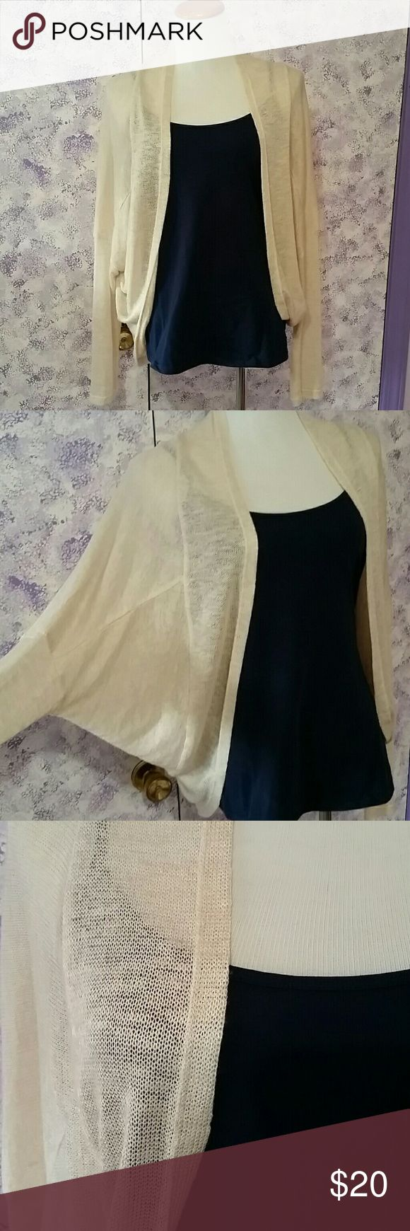 NEW LISTING--Beautiful cream dolman cardigan This is a beautiful dolman sleeved, open-front sweater with an open front. Gorgeous with a navy tank and silver jewelry! Very light weight, small knit, and can easily dress up a pair of jeans.  No snags, holes, tears, stains. NEW WITHOUT TAGS! Apt. 9 Sweaters Cardigans