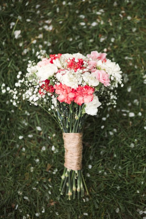 pink and white carnation and gypsophila bouquet, wrapped in twine for a simple country-like style