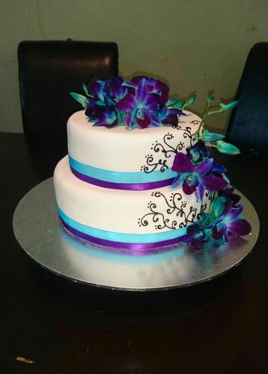 Blue and purple orchids wedding cake                                                                                                                                                                                 More