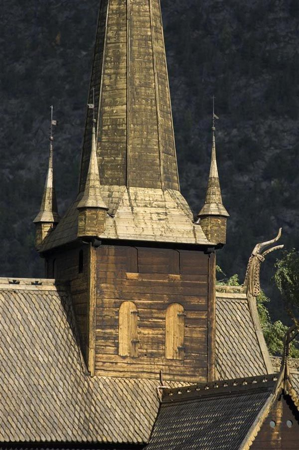 """Stave church, Lom, Oppland, East Norway: A stave church is a medieval wooden church with a post and beam construction; the load-bearing posts (""""stafr"""" in Old Norse) have lent their name to the building technique."""