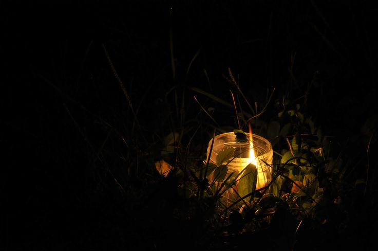 A candle in the grass