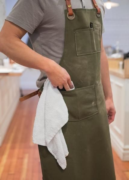 Pounding, sawing, painting, cutting, chipping, spraying and hammering can take a toll on your attire. This work apron protects your clothes and looks good at the same time.