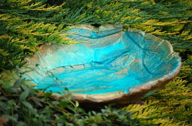 Exquisite turquoise blue stained concrete, gold and blue patinated handmade birdbath.