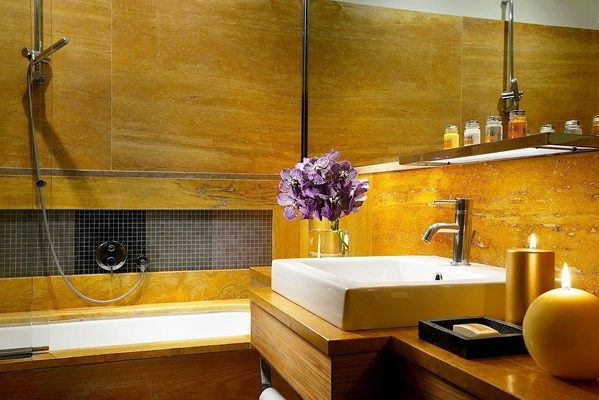 Babuino 181 in Rome, Italy - Superior Room: The large bath is finished in marble and mosaic, and lush bathrobes and towels are Frette.