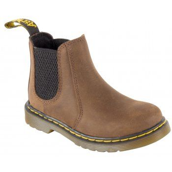 The Banzai Boot takes Dr Martens classic Chelsea boot silhouette and makes it mini for smaller feet! Crafted in a lightweight, Full-Grain leather, these Boots are built for maximum comfort and durability. Let your little rebels stamp around all day on our signature air cushioned sole. http://www.marshallshoes.co.uk/childrens-c20/dr-martens-kids-boys-banzai-dark-brown-ankle-boots-16708201-p3212