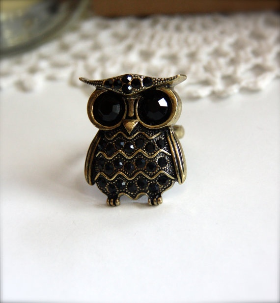 Love rings but don't tend toward anything other than silver.  Definitely no stones.  Rather like this fellow, though.