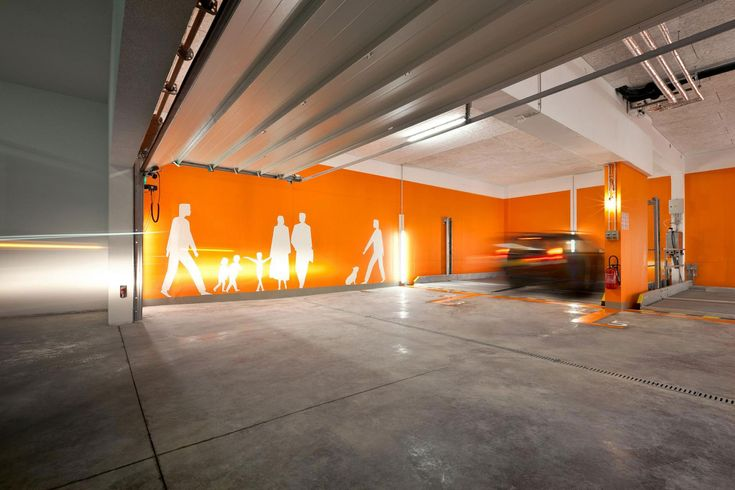 Amusing Parking Garage Designs With Orange Wall Painting And Grey Concrete Floor Parking