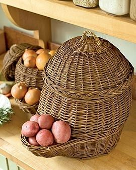 Keep Your Potatoes and Onions in Old World Vegetable Baskets   Plastic grocery bags retain moisture, speeding the demise of potatoes and onions. These breathable woven baskets, used for centuries in Europe, are a better solution. They fill from the top, and dispense vegetables from the pocket below….genius!