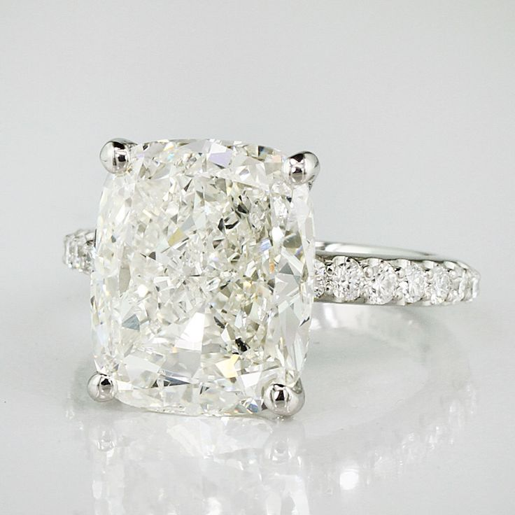 We recently finished this amazing 6.01ct Cushion cut diamond engagement ring- don't you love it? This gorgeous confection was mounted on a custom-designed diamond eternity band in Platinum!