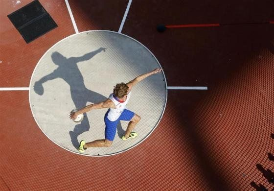 France's Kevin Mayer competes in the men's decathlon discus throw event at the London 2012 Olympic Games at the Olympic Stadium August 9, 2012.