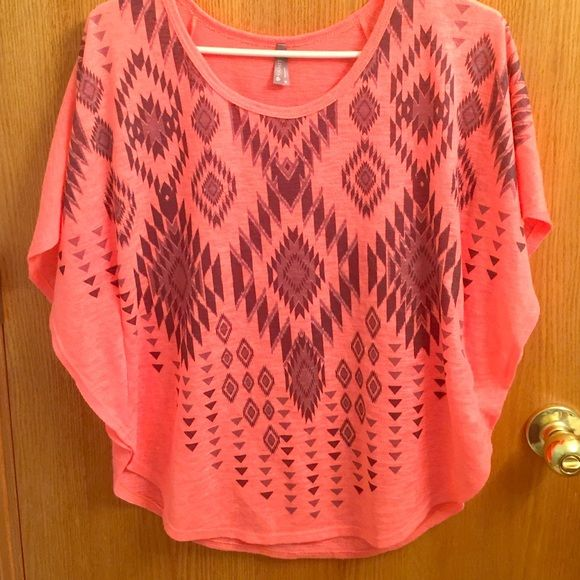 pink and Aztec tee :) pink and black Aztec t-shirt type pinch styled shirt. hardly worn. perfect condition. Vanity Tops