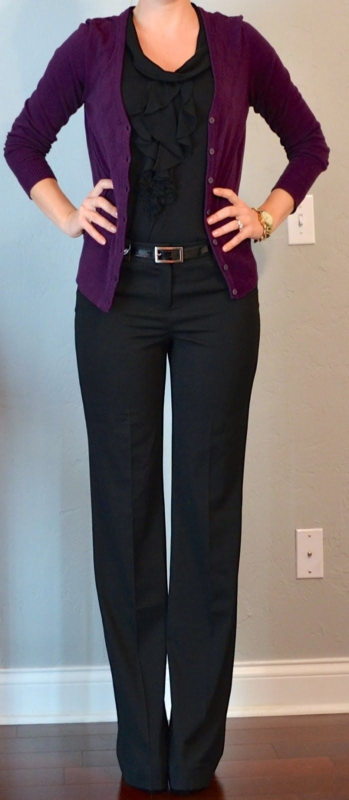 Plum sweater over classic charcoal business outfit
