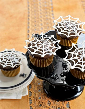 Spider web cupcakes - melt white chocolate and put in piping bag to make webs. Cool and put on top of frosted cupcake.