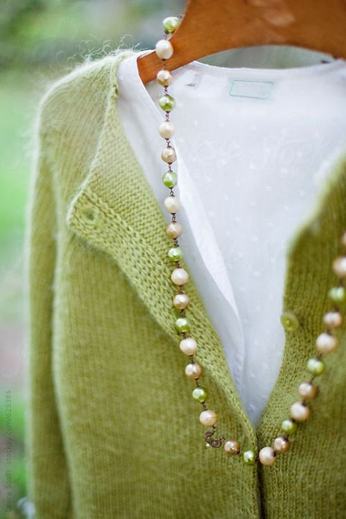Love the green cardigan with the white blouse and the accent of pearls