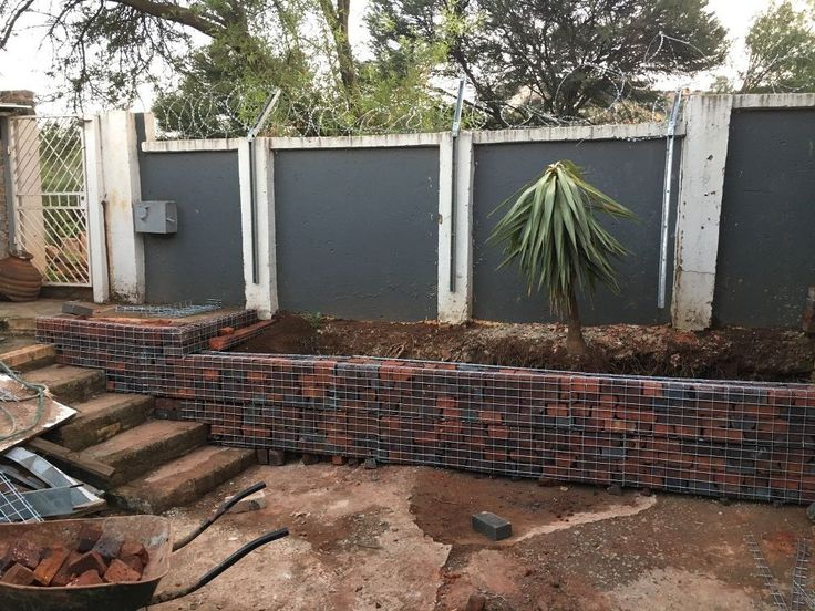 unbelievable curved gabion wall.  My fianc couldn t take the eyesore in our backyard See what she 529 best Gabion images on Pinterest wall Decks and