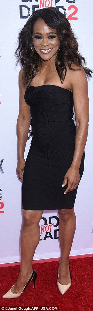 Flawless! Robin Givens, 51, looked exquisite in a strapless black mini dress which highlighted all her best assets