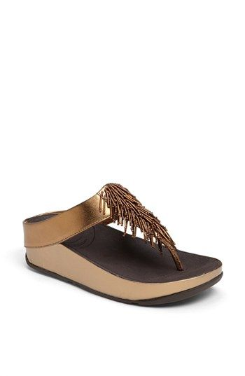 Free shipping and returns on FitFlop 'Cha Cha™' Sandal at Nordstrom.com. Relax in style with a comfy sandal featuring a low wedge. MICROWOBBLEBOARD™ midsole technology fuses three diagonal sections of triple-density EVA into a single, seamless, underfoot platform to absorb shock and diffuse high-pressure spots.