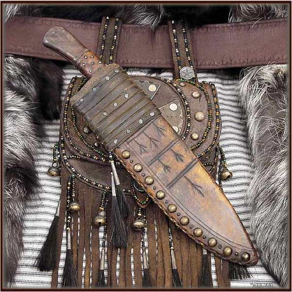 Mountain Man Bowie Knife and Sheath over a Scottish Sporran. this would be cool…