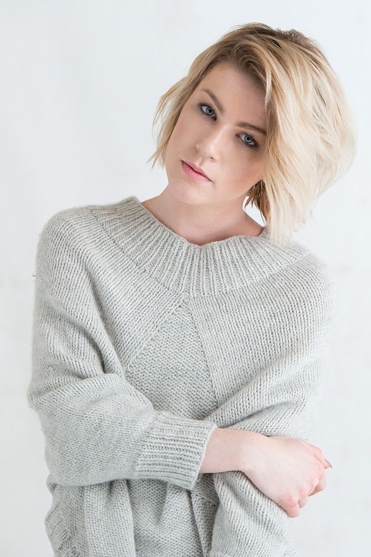 """The Marblehead Poncho is worked in the round from the top down in one piece. Ribbing and a panel of reverse stockinette provide visual interest. Part of knit.wear's """"Athleisure"""" story, this knitted poncho pattern is sure to be a favorite!"""