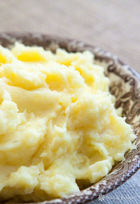 Heavenly mashed potatoes recipe using buttery Yukon Gold potatoes, cream, butter, milk, salt and pepper. ~ SimplyRecipes.com