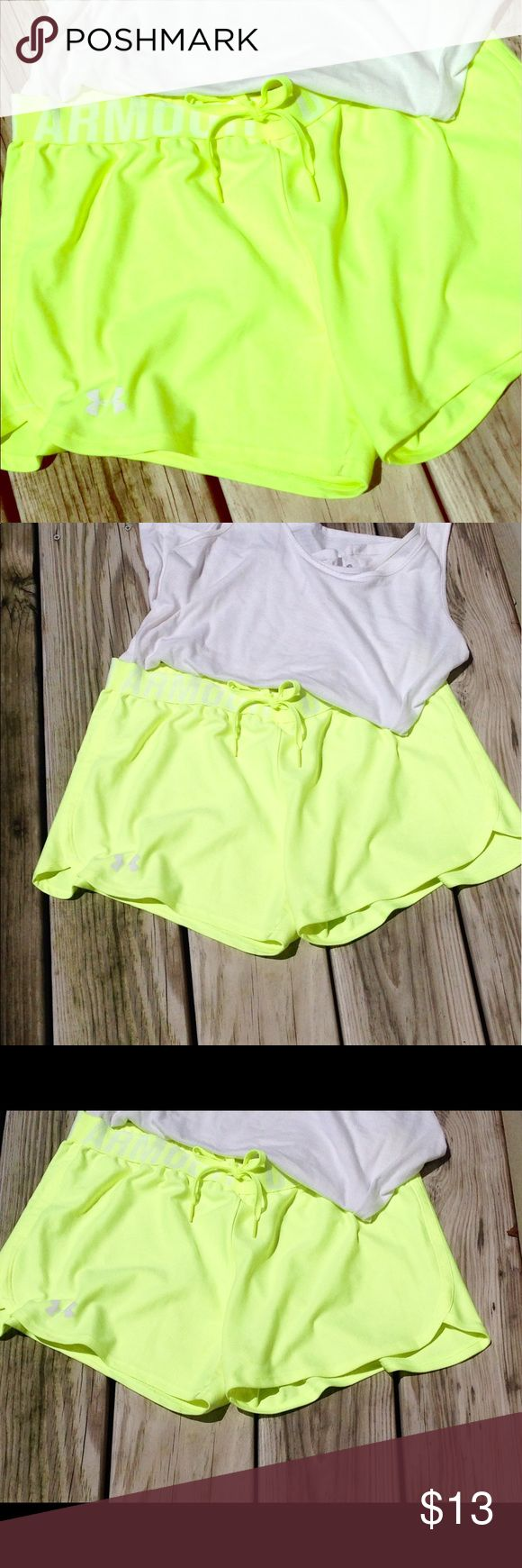 Under Armour neon yellow shorts Bright and bold. Drawstring with wide elastic waistband. Workout ready! Under Armour Shorts