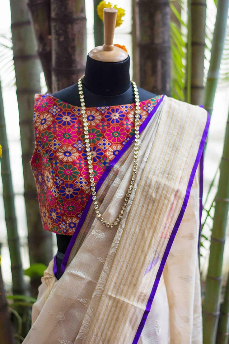 A truly versatile blouse this…floral weave in shades of green, white, orange, purple and pink, give this simple boat neck blouse the freedom to pair with sarees in myriad colors and shades. Pair with an inspiring off white saree to make this blouse truly stand out. Whatsapp +91 81050 68601. *Shipping worldwide* #saree #blouse #sareeblouse #blousedesigns #desi #indianfashion #india #bollywood #multicolour #brocade #boatneck