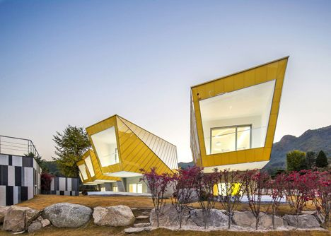 Asymmetric holiday homes by Studio Koossino feature bright yellow walls