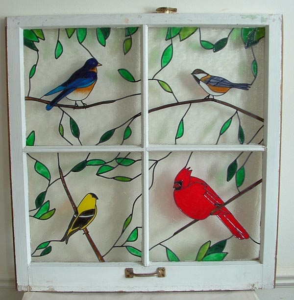 Birds painted on old wooden window