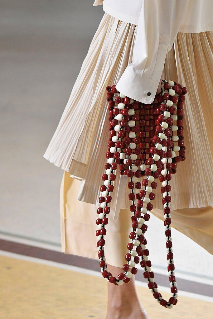 Lemaire The fun, hippie-ish spirit of a '70s-inspired beaded bag feels perfectly modern, thanks to long straps and large wooden beads.