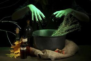 Witch Party Decorations | Use cauldrons and apothecary bottles to decorate a witch-themed party.