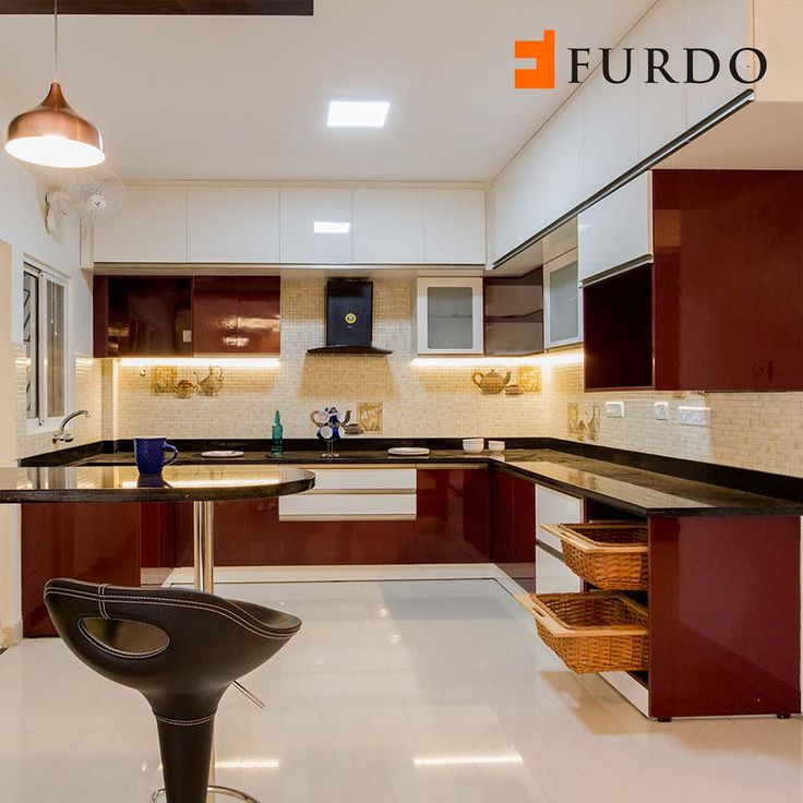 Beautiful white and maroon Kitchen with breakfast counter ...