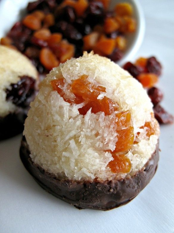 Apricot and Cranberry Macaroons (Gluten Free and Kosher for Passover)- chewy, moist coconut speckled with chopped dried apricot and cranberries, and dipped in dark chocolate   The Monday Box