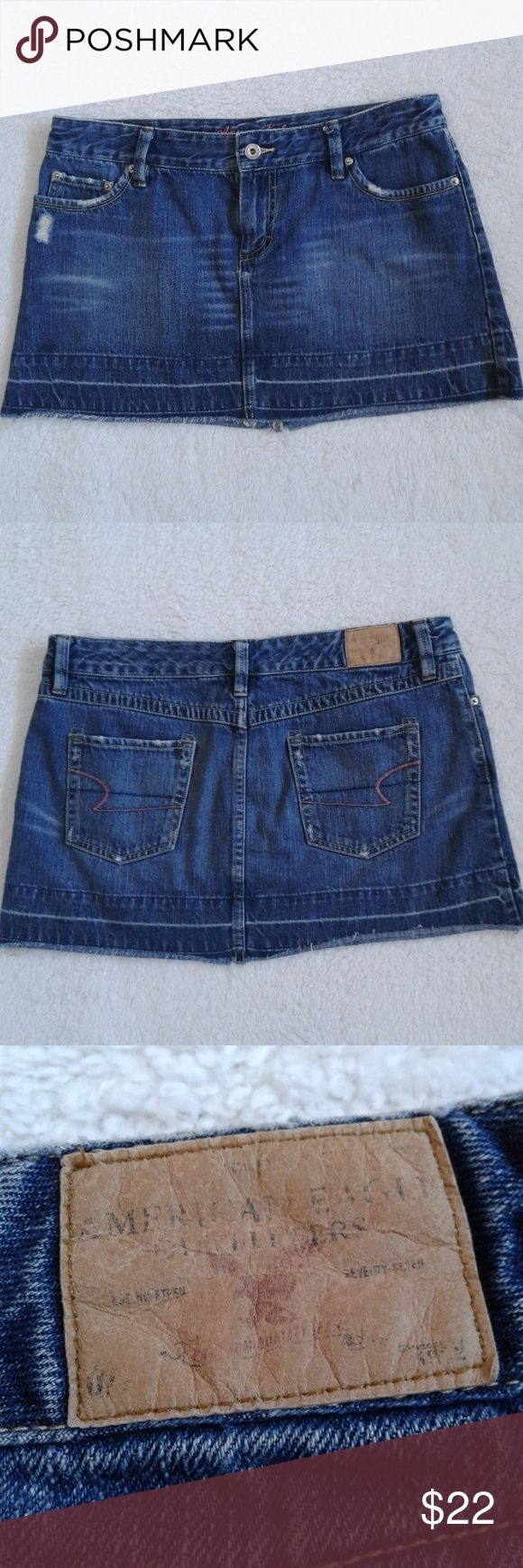 American Eagle Denim Mini Skirt Great condition. Some distressing. Cute mini skirt perfect for the summer months!  Materials:  100% cotton   Approximate measurements:  Waist: 17 inches  Length: 13 inches down the outer seam, 12 inches down the middle seam (photo above, sorry the lighting is making the skirt look lighter in this photo) Hem: 21 1/2 inches   Bundle up! Offers are always welcome!  Any questions, just ask! American Eagle Outfitters Skirts Mini
